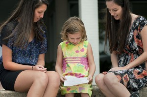 Seniors visit with a first-grader.