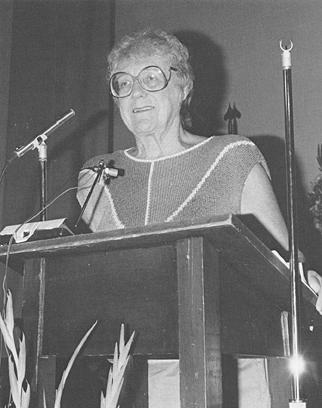 Patty Masterson welcomes attendees to the first Common Wealth in Education Conference, 1986