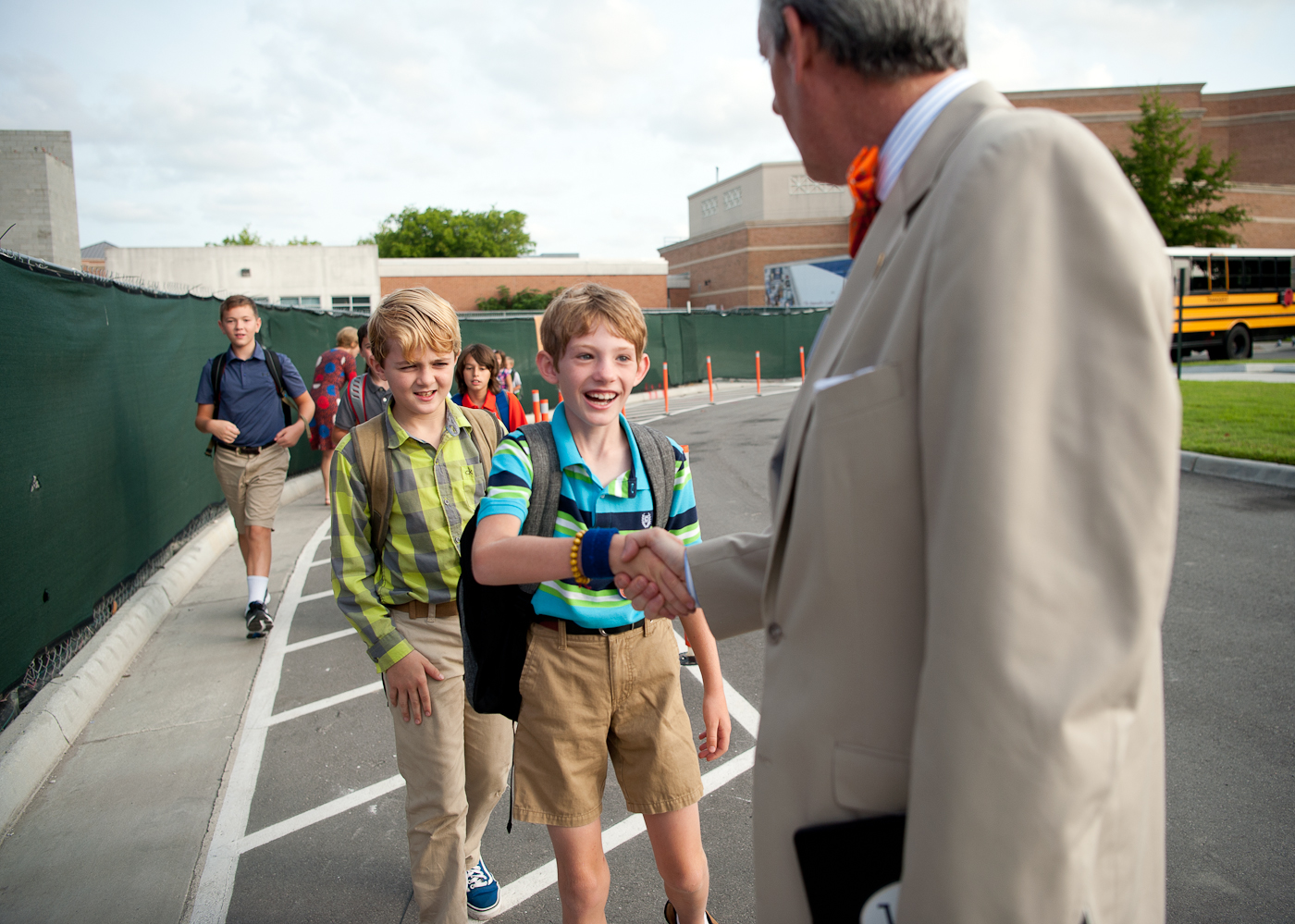 Mr. Manning greets students with a handshake on their first day of school.